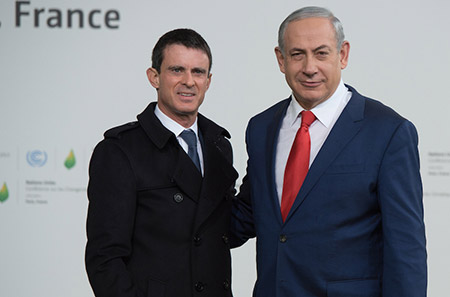 Israeli Prime Minister Benjamin Netanyahu, right, joins his French  counterpart, Manuel Valls, at the United Nations Climate Change  Conference in Le Bourget, France.