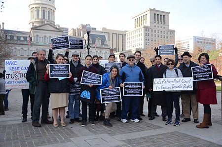 Members of Jews United for Justice demostrate near City Hall in Baltimore as part of an effort to improve conditions for tenants going to rent court.