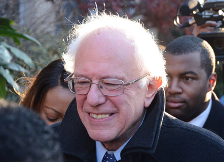 Sen. Bernie Sanders walks through the Sandtown-Winchester neighborhood during a visit to the city on Dec. 8.