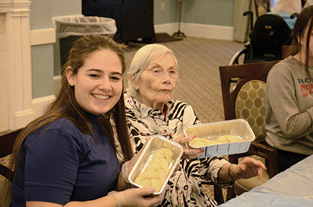 Residents of Peregrine's Landing at Tudor Heights joined members of Yachad, the National Jewish Council for Disabilities, for a challah bake on Dec. 20. The event concluded Yachad's weekend-long leadership summit. (Daniel Schere)