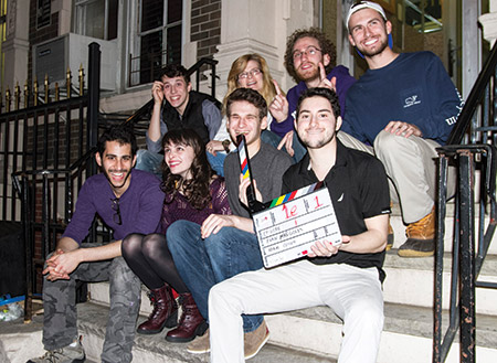 """Members of the cast and crew from """"Josh Has a Genie"""" pose for a photo before running a scene. Top row (from left): Dylan Margolis, Diane Smith, Zak Ferentz and Mike Brash. Bottom row (from left): Evan Margolis, Kelsey Lake, Josh Margolis and Adam Cohen. (Provided)"""