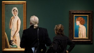 "Visitors look at Max Beckmann's ""Portrait Quappi Beckmann"" from 1925 at the Hypo-Kunsthalle in Munich."