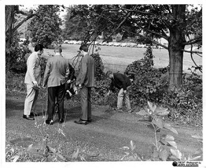 Detectives examine the site where the body of Esther Lebowitz was found. (Courtesy of the Jewish Museum of Maryland, 1996.26.235/Jerry Esterson)
