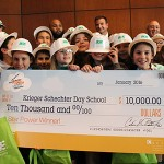 "The fourth-grade class that won BGE's ""Wires Down"" contest poses for a photo with a check for $10,000. (photo by Justin Katz)"
