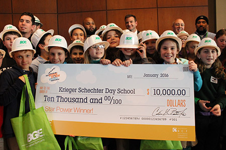 """The fourth-grade class that won BGE's """"Wires Down"""" contest poses for a photo with a check for $10,000. (photo by Justin Katz)"""