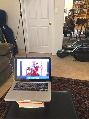 Due to the storm, Amit Peled conducts a music lesson with one of his students via Skype. (Provided)