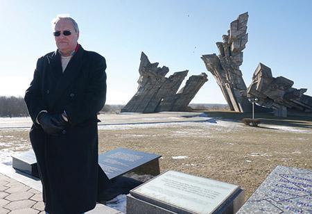 Nazi hunter Efraim Zuroff says Kaddish, the mourner's prayer, for Holocaust victims near Kaunas, Lithuania.