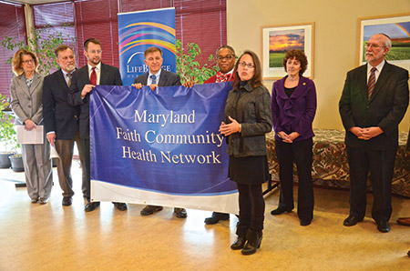 The Pearlstone Center hosted the launch of the Maryland Faith Community Health Network. From left: Carolyn Quattrocki, executive director, Maryland Health Benefit Exchange; the Rev. John Deckenback, chairman, Ecumenical Leaders Group; Dr. Jonathan Ringo, vice president of transformational care, LifeBridge Health; Vincent DeMarco, president, Maryland Citizens' Health Initiative and head of the Consumer Outreach Task Force of the Health Services Cost Review Commission; the Rev. Cleveland Mason, president, United Baptist Missionary Convention; Carmela Coyle, president and CEO, Maryland Hospital Association; District 11 Del. Shelly Hettleman; and Rabbi Jay Goldstein, Beth Israel Congregation. (Photo by Melissa Gerr)