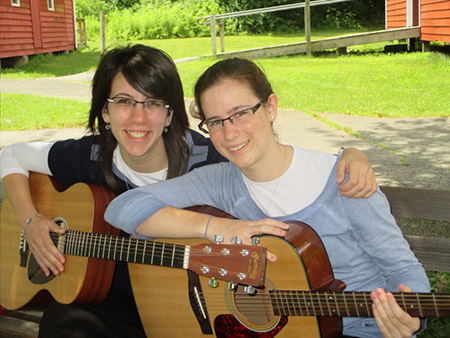 Chani Levy (left), pictured here with camper Rachel Evans, teaches singing, songwriting and guitar at Camp Tizmoret Shoshana. (Provided)