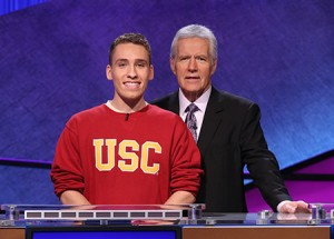 "Sam Deutsch poses with ""Jeopardy!"" host Alex Trebek after winning the show's college tournament. (Courtesy of Jeopardy Productions, Inc.)"
