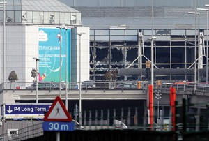 Shattered windows at Zaventem Airport show the devastation caused by a suicide bomber. (Gareth Fuller/PA Wire via ZUMA Press/Newscom)