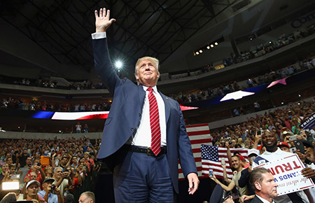 Donald Trump waves to the crowd at a campaign rally in Dallas.