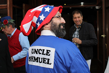 """Rabbi Velvel Belinsky displays a mix of American patriotism and  Jewish heritage by dressing up as Uncle """"Shmuel"""" during ARIEL's Purim party at Kali's Court in Fells Point. (Justin Katz)"""