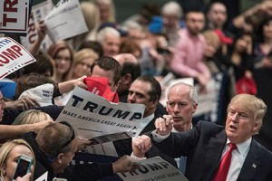 Republican presidential hopeful Donald Trump signs autographs at a campaign rally in Concord, N.C. (Sean Rayford/Getty Images)
