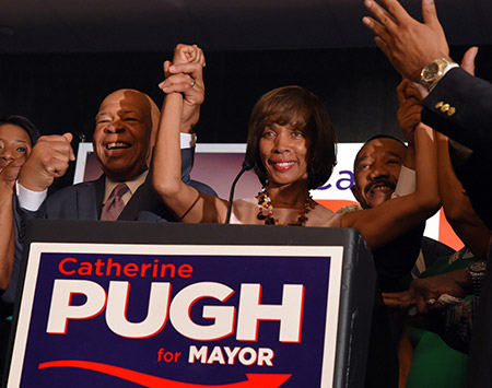 Baltimore mayoral candidate Catherine Pugh on election night, with her staff and supporters, including Rep. Elijah Cummings (left), at the Baltimore Harbor Hotel on Tuesday, April 26, 2016. (Pugh: Lloyd Fox/TNS/Newscom)