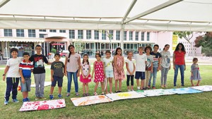 Jewish and Arab students enrolled in Achla show off their art projects. (Provided)