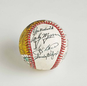 This custom baseball signed by Sandy Koufax and other Hall of Famers, including Yogi Berra, is a prized possession in the Jeff Aeder collection.