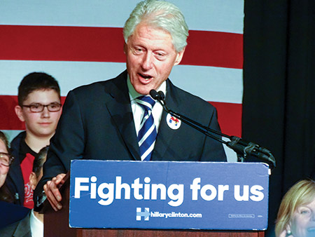 With the Maryland primary two weeks away, former president Bill Clinton touts the former secretary of state, Hillary Clinton, as best qualified to be president to a crowd at Leisure World. (Photo by Daniel Schere)