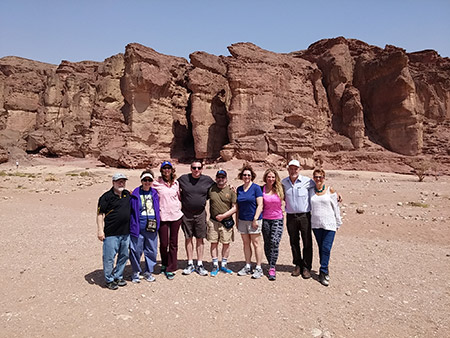 Karen Blum (fourth from right) poses for a photo in Timna Park with (from left) her uncle, Bob Chudnow; her mother, Lois Infeld; her aunt, Teri Chudnow; her husband, Jeff Blum; her uncle, David Chudnow; her cousin, Elizabeth Chudnow; Mayor Udi Gat of the Eilot Region; and park manager Hagit Gal.