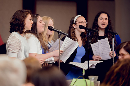 """Mezumenet, the all female Jewish a cappella group from the University of Maryland, College Park, entertained during the Associated Women's """"Freedom to Create Passover Experience."""" (David Stuck)"""