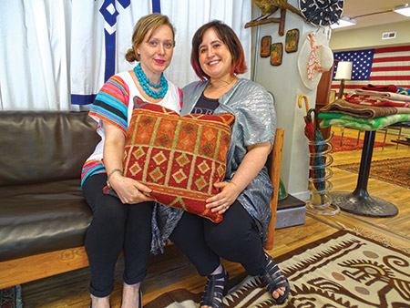 Athena Hoffberger (left) and Julie Lilienfeld started Wishbone Reserve in 2014 after the two entrepreneurs met and shared their vision  of opening a consignment store with unique, well-made merchandise. (Daniel Schere)