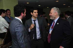 Chanan Weissman, center, speaking with Jewish Federations Washington director William Daroff, right, and Jordan Hirsch. (Ron Sachs from CNP/Courtesy of Jewish Insider)