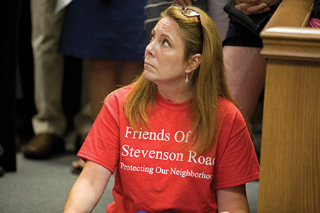 Neighbors opposed to the synagogue wore these red T-shirts. (Marc Shapiro)
