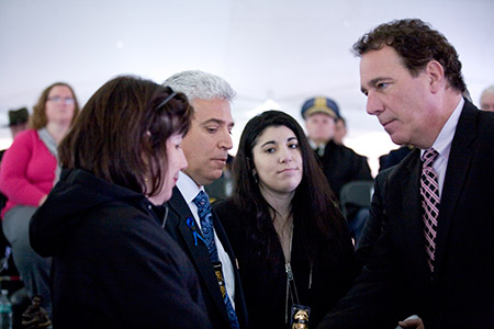Baltimore County Executive Kevin Kamenetz (right) gives his regards to Noah Leotta's parents(from left), Marcia Goldman and Richard Leotta, and sister Shana. (Marc Shapiro)