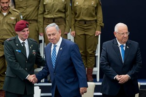 Prime Minister Benjamin Netanyahu shakes hands with Israel Defense Forces deputy chief of staff Yair Golan alongside President Reuven Rivlin at an Israeli Independence Day ceremony for outstanding  soldiers on May 12. (Photo by Yonatan Sindel/Flash90 via JTA)