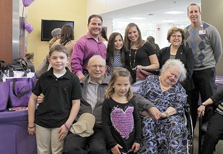 """Back row, from left: Steve Venick, Jordyn Venick, Holly Venick, Ilene Rosenthal, program director at the Alzheimer's Association and John Ottena, manager of therapeutic recreation and volunteer services at Levindale. Front row, from left: Jordyn's siblings and grandparents Hunter Venick, Herman Venick, Marley Venick and her bubbie, Beverly """"Bubbles"""" Venick. (provided)"""