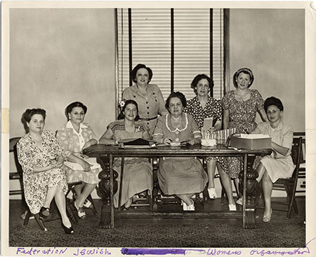 From left, Florence Liltzer, Rose Meyers, Elsie Caplan, president Flora Dashew, Elsie Herman, Sara Sherbow, Peggy Weiner and an unidentified woman, volunteer on behalf of the Jewish Armed Services, circa 1950. (Courtesy of the Jewish Museum of Maryland, 1993.159.054)