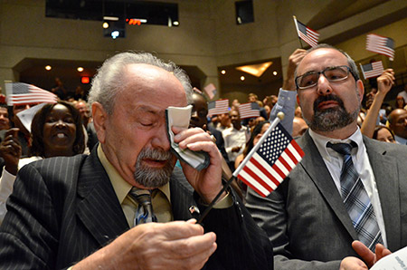 Vladimirovich Abramovich Girshevitskiy, 80, was overcome with emotion moments after he became a U.S. citizen on June 20 at the first-ever naturalization ceremony held at the U.S. Holocaust Memorial Museum. Thirty-seven people became naturalized at the event, which was in honor of World Refugee Day. (Melissa Gerr)