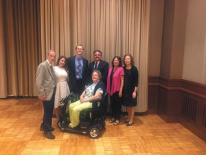 """ENCHANTED: Baltimore Hebrew Congregation's Brotherhood held its closing dinner on June 5, which included """"An Evening of Enchanted Music."""" Pictured, from left, is Brotherhood President  Sidney Bravmann, soprano  Kimberly Christie, baritone Jason Buckwalter, pianist James Harp, Arlette Hurt and Diane Bravmann, and Paula Cohen (front). (Photo provided)"""