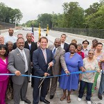 Baltimore County Executive Kevin Kamenetz (holding scissors) marks the opening of a new 1.2-mile section of Owings Mills Boulevard. (Photo provided)