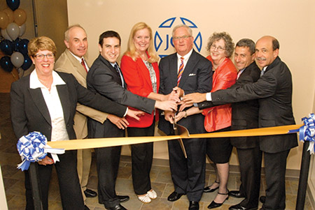 From left: Barbara Levy Gradet, Izzy Patoka, Rabbi Benjamin Sharff, Councilwoman Vicki Almond, Brian Goldman, Nancy Kohn Rabin, Sen. Bobby Zirkin and Bruce Sholk at the ribbon cutting for JCS Owings Mills offices in April 2012 (Photo provided)
