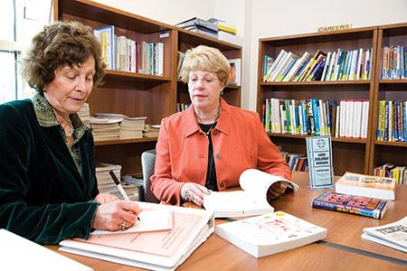 From left: Eva Schwartz, then-JCS director of economic services, and Barbara Levy Gradet; the JCS building (File photo)