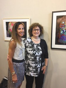 "Betsy Rascoe (left), who modeled to support a friend, asked artist Sandie Heiss for something ""whimsical, happy."" (Toby Tabachnick)"
