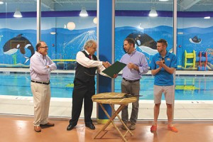 The Goldfish Swim School opened its newest location in Owings Mills on Cronridge Drive. Reisterstown-Owings Mills-Glyndon Chamber of Commerce board chair Bob Frank (second from left)  welcomed the swim school on Wednesday, June 15. From left: owner Michael Solarz, Frank, vice president of operations Sean Flanigan and general manager Zachary Healy. (Rachel Millman)