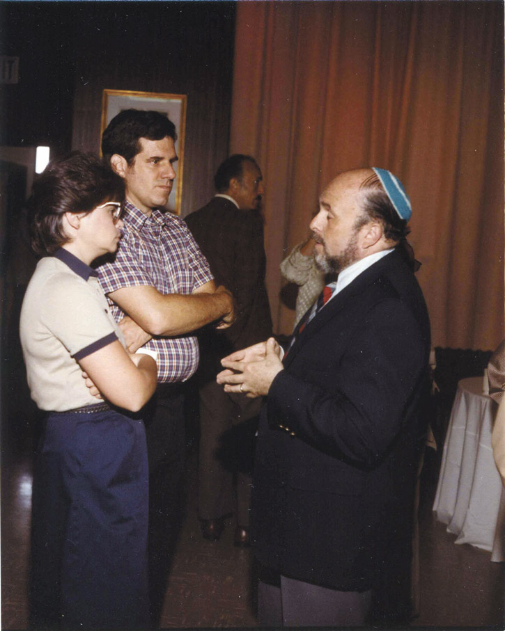 Guests chat after the groundbreaking  ceremonies for the Beth Israel chapel  wing, circa 1984.  Can you identify anyone in this photo? Contact Joanna Church, 410-732-6400, ext. 226 or jchurch@jewishmuseummd.org. To see more of the Jewish Museum's extensive collection and find  out who has been identified in past photos, visit  jewishmuseummd.org/tag/once-upon- a-time-2/. (Courtesy of the Jewish Museum of Maryland, 1994.53.79.28)