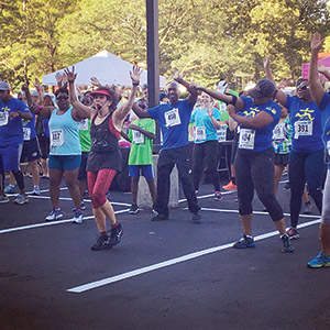 Participants warm up at the Miles that Matter Pikesville 5K Run And Walk, which was held on Sunday, July 10 to benefit the Pikesville Chamber of Commerce and the Ulman Cancer Fund. (Provided)