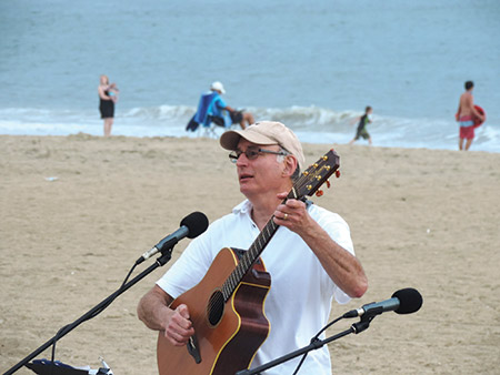Baltimore Hebrew Congregation Cantor Robbie Solomon led a Beach Shabbat service at Delaware Seashore State  Park on July 8. Berlin congregation Temple Bat Yam joined BHC, and Rosenfeld's Jewish Deli was on hand to serve hungry beachgoers. (Provided)