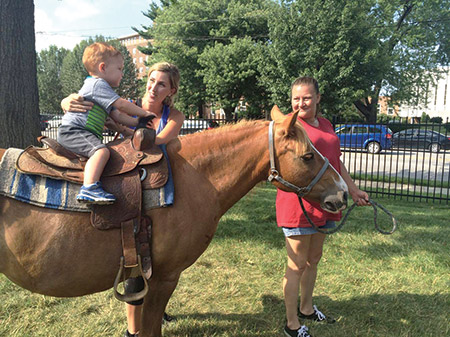 The Park Heights JCC hosted a day of family fun on Tuesday, July 12. As part of the petting zoo, participants were able to ride a horse. (Provided)