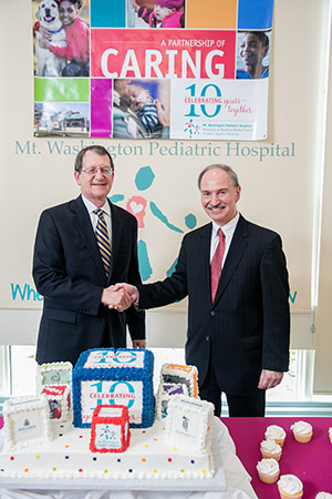 Ron Peterson (left), president and CEO of Johns Hopkins Healthcare, and Robert Chrencik, president and CEO of the University of Maryland Medical System, gather at Mount Washington Pediatric Hospital to celebrate 10 years of joint ownership of the children's hospital. More than 50 people attended the event last month including Dr. Howard Haft, deputy secretary of the Maryland Department of Health and Mental Hygiene, Dels. Dan Morhaim and Sandy Rosenberg, as well as Sheldon Stein, president and CEO of Mount Washington Pediatric Hospital. (Provided)