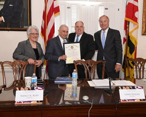 From left: Maryland Treasurer Nack K. Kopp. Earle Freedman, Gov. Larry Hogan and Comptroller Peter Franchot at a ceremony on July 6, where Hogan presented Freedman with a commendation for his years of service. (Office of the Governor of Maryland)