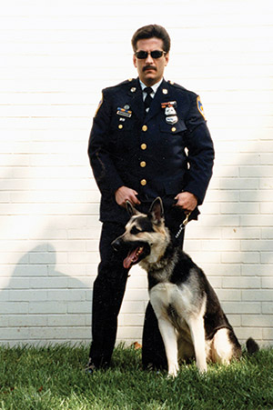 Ken Dickstein poses with his K-9 partner, Niko, who he adopted after the dog was retired from the police. (Provided)