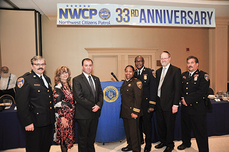 From left:Officer Sam Bennett, citywide Jewish community liaison for the City Council president's office Betsy Gardner, Baltimore City Police Department Public Information Officer Jeremy Silbert, Baltimore City Sherriff's Office Major Sabrina Tapp-Harper, Baltimore City Police Captain Bernie Douglas and Northwest Citizens Patrol President Neil Schachter with Ken Dickstein at the 33rd anniversary of the NWCP, where the organization presented him with an award recognizing his service to the city and community.