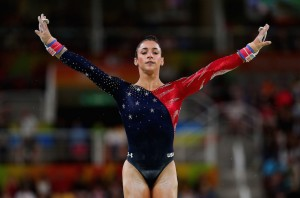 RIO DE JANEIRO, BRAZIL - AUGUST 07:  Alexandra Raisman of the United States reacts after competing on the uneven bars during Women's qualification for Artistic Gymnastics on Day 2 of the Rio 2016 Olympic Games at the Rio Olympic Arena on August 7, 2016 in Rio de Janeiro, Brazil  (Photo by Tom Pennington/Getty Images)