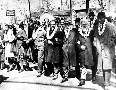Rabbi Abraham Joshua Heschel (second from right) marches with Martin Luther King Jr. and other civil rights leaders in the 1960s.