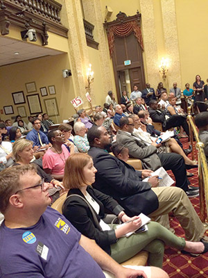 Members of the press and community attend a city council meeting in which a $15 minimum wage was discussed. (Justin Silberman)