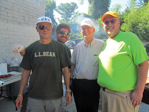 From left: Ner Tamid Greenspring Valley Synagogue members Eugene Schmeltzer, Chaim Cotton, Dr. Stanley Gelber and Mark Schwartzman are all smiles at the synagogue's end-of-summer barbecue bash on Sunday, Aug. 28. The event featured a magician, moon bounce, door prizes, a petting zoo, art projects, snow balls,  carnival games, bingo and of course, hamburgers and hotdogs. (Provided)